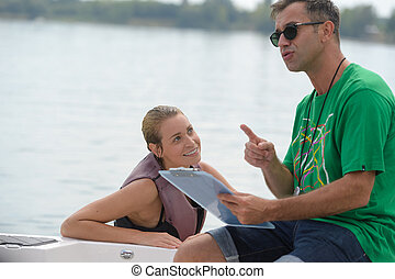 wakeboarder talking to instructor