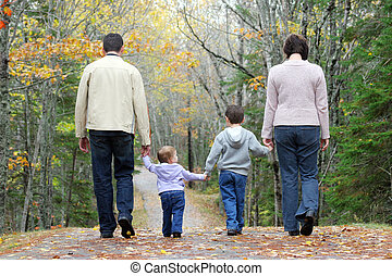 A family walking through the woods