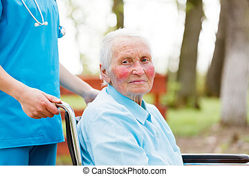 Walking with an Elderly Lady in Wheelchair