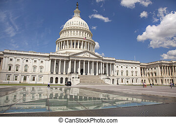 WASHINGTON D.C. - MAY 23 2014: The United States Capitol is the meeting place of the United States Congress, the legislature of the U.S. federal government. Located in Washington, D.C., it sits atop C