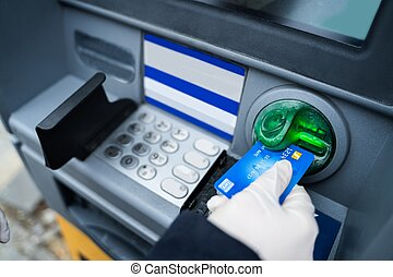 Wearing Gloves While Using ATM