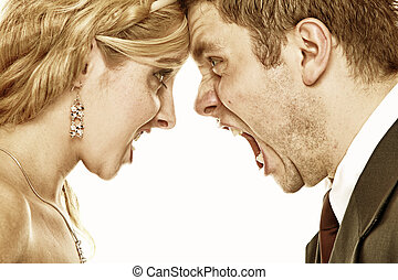 Wedding couple relationship difficulties. Angry woman man yelling at each other. Portrait fury bride groom. Face to face.