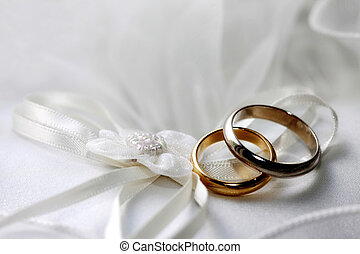 Wedding rings on a satiny fabric