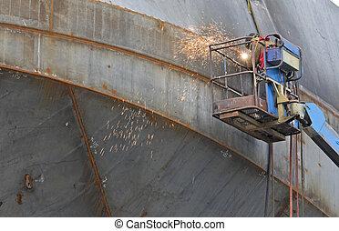 Welder at shipyard