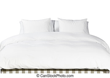 Comfortable soft white pillows and blanket on the bed