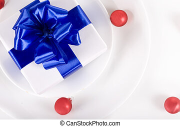 White present with blue ribbons