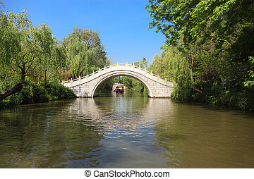 White stone footbridge in an Asian garden