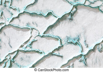 White-turquoise texture of Pamukkale calcium travertine in Turkey.