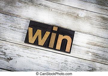Win Letterpress Word on Wooden Background