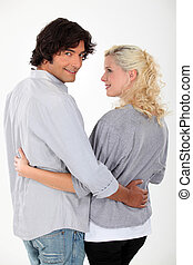 Woman affectionately looking at her husband