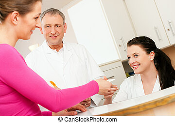 Woman at reception of clinic