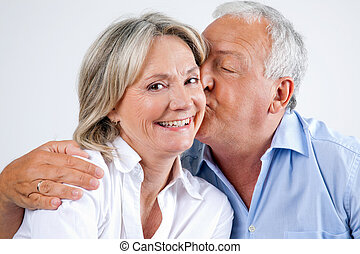 Woman Being Affectionately Kissed By Her Husband