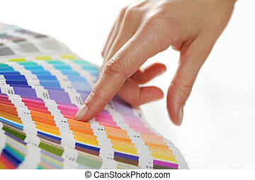 woman Choosing color from color scale