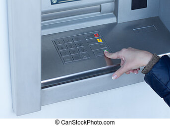 Woman completing a transaction on an ATM