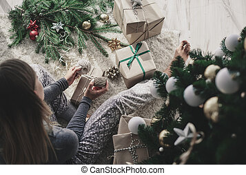 Woman decorating a christmas present
