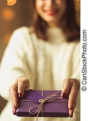 Woman giving christmas gift