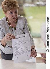 Woman giving husband divorce paper