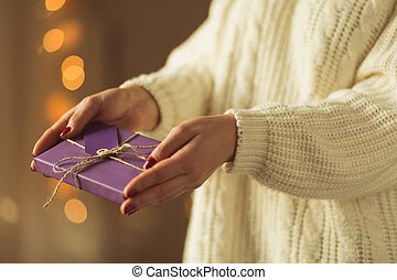 Woman giving xmas present