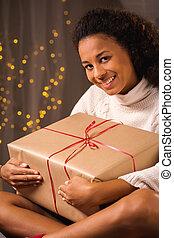 Woman holding a big present