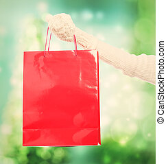 Woman holding a big red shopping bag