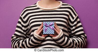 Woman holding a present box