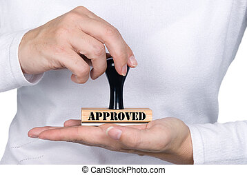 A woman holding an approval authorization stamp