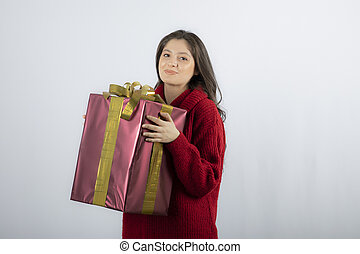 Woman holding Christmas or new year decorated gift box