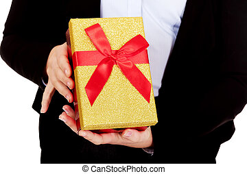 Woman holding christmas present with red bow