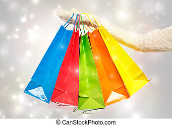 Woman holding colorful shopping bags