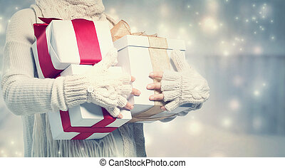 Woman holding many present boxes