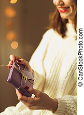 Woman holding packed present