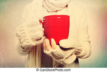 Woman holding red mug