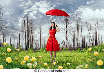 Woman in red dress with umbrella in dry forest