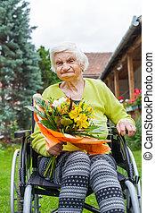 Woman in wheelchair celebrating