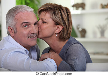 Woman kissing her husband
