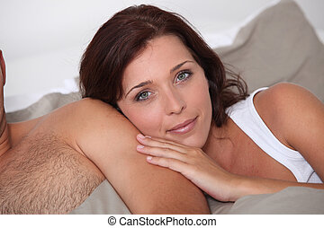 Woman leaning against her husband