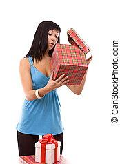 woman looking at a gift box