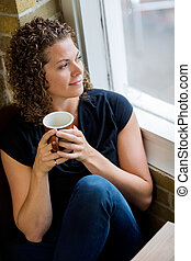 Woman Looking Through Window In Cafe