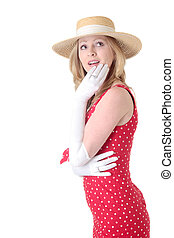 woman looking up wearing retro fashion with straw hat