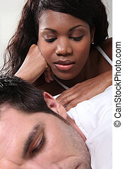 Woman massaging her husband