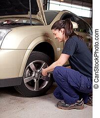 Woman Mechanic Tire Change