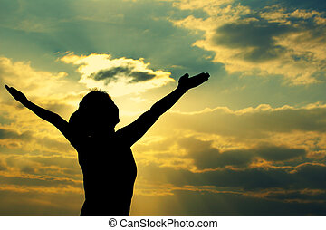 woman open arms under the sunrise
