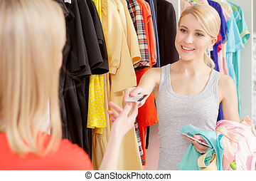 Woman pays with a credit card