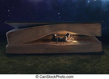 Woman reading inside a huge book