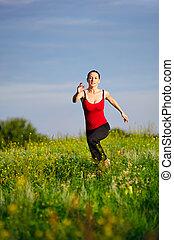 Woman running on a sunset field