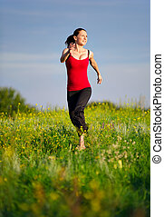 Woman running on a sunset field