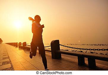 woman running sunrise seaside