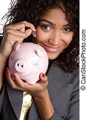 Woman saving money with piggy bank