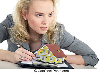 woman signs purchase agreement
