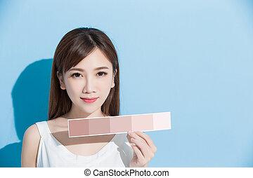 woman take skin color scale